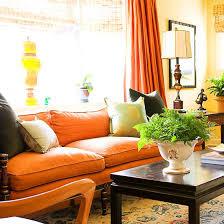 decorating in orange sofa covers orange and linens