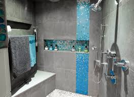 close up of large shower with shower niche on time baths kitchens