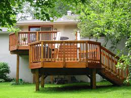 exterior exterior design featuring wooden deck elevated stairs