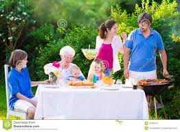 big happy family enjoying bbq grill in the garden stock photo