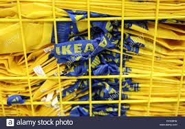 yellow plastic bags of the company ikea lie in a basket at the