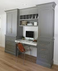 black and white kitchen with drop down desk with overhead pigeon