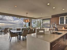 kitchen cabinets veneer wall of glass this open kitchen dining space features a waterfall