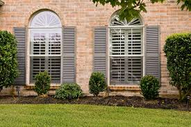exterior view an exterior view of plantation shutters on two windows an exceptional brick home jpg