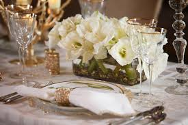 green white and gold centerpieces at the angus barn from blossom