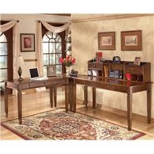 ashley furniture corner table hamlyn 4 piece l shaped desk by ashley furniture at becker furniture