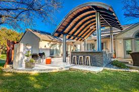Patio Metal Roof by Patio With Modern Steel Roof And Outdoor Fireplace Hgtv Ultimate