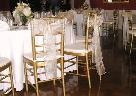 black chiavari chairs black gold gold chairs ribbon bow subtle and simple leaving