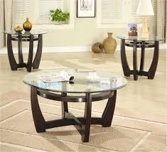 glass circular coffee table with red bulb base city furniture hire