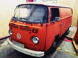 orange volkswagen van this volkswagen van will be converted into a mobile radio station