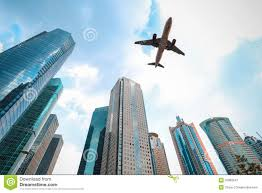 modern buildings modern buildings with airplane royalty free stock photography