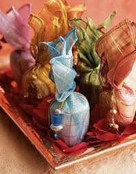 Indian Wedding Gift Scented Votives In Organza Potlis Indianweddings Gift Ideas