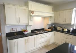 ivory kitchen units with black worktops http www