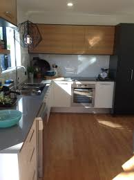 kitchen design modern warm timber contrasted with dark charcoal