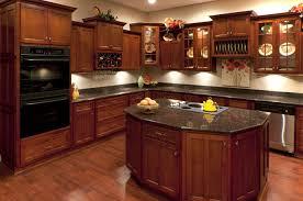 dark cherry cabinets with black granite countertops