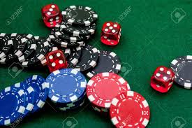 poker table top and chips stunning poker chips and dice on a green gaming table top view stock