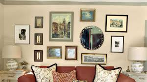 how to hang a collection of artwork southern living