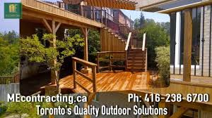 cedar deck with pergola and interlock basement walkout in toronto