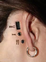strange earrings conection ear earring eat image 526430 on favim