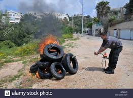 fireman lights tyres as part of a fighting drill stock photo