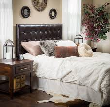 black tufted leather headboard installed in the bathroom with