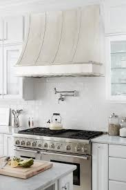 satin nickel white kitchen love everything about this a burnished nickel kitchen hood by thomas traders stands over a