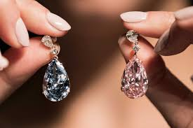 pink star diamond ring a pair of diamond earrings sell for 57 4 million at auction