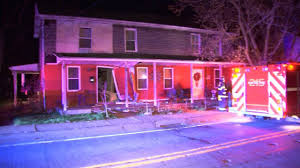 pictures of home car crashes into front door of home woman on couch feet away wpxi