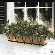 Christmas Window Box Decorating Ideas by Here Is One That Takes The Natural Look Just One Step Further With