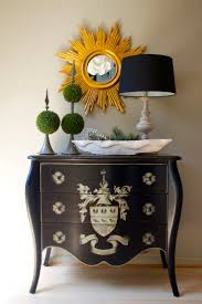small foyer ideas like this grouping for top of cabinet under the