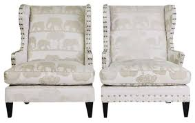 Wing Back Armchairs Cream On Cream Wing Back Chairs With Elephants 1 999 Est