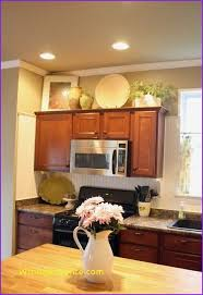 Above Kitchen Cabinet Decorations Awesome Space Above Kitchen Cabinet Decorating Ideas Home Design