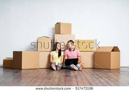 Chair Boxes Moving Young Woman Looking Contents Moving Boxes Stock Photo 144903427