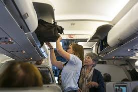 Does United Airlines Charge For Bags The New Thin Line Between Carry On And Checked Bags Wsj