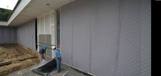 stop noise on your construction site using sound blankets and
