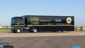 renault trucks 2014 renault truck jumps over lotus f1 car and sets guinness record video