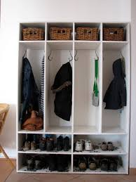 white homemade mudroom with shoe rack storage and hanging coat