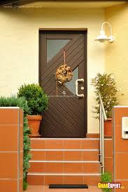 main entrance door design in dark brown wood gharexpert main entrance door design in d