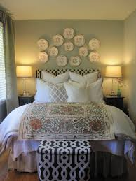 awesome white bedroom for guests with unique head wall decors
