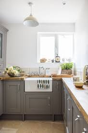 grey kitchen cabinets b q real home a cosy renovated cottage makes the