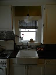 recessed light over kitchen sink and using small sliding glass