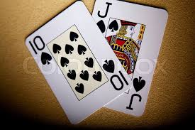 cards on the table two cards for game in poker ten peak and a peak jack cards on a