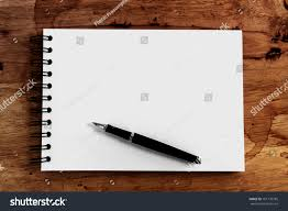 pen writing on paper close opening note paper pen on stock photo 161139785 shutterstock close up opening note paper and pen on wood texture background with copy space