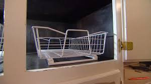 kitchen cabinets baskets how to add roll out wire baskets to kitchen cabinets today s homeowner