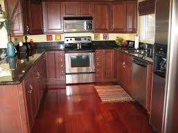 varnished island peninsula stainless kitchen dark brown cabinets
