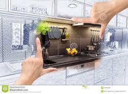 female hands framing custom kitchen design stock photo image
