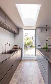 another example cost saving leaving existing wall section modern kitchen extension sleek design framed garden views floor ceiling window