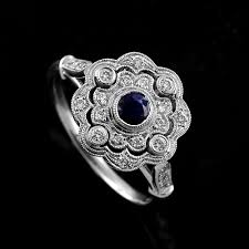 white gold art deco sapphire diamond flower halo engagement ring