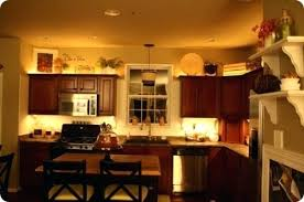 whats on top of your kitchen cabinets home decorating top of cabinet decor ideas how to decorate above kitchen cabinets