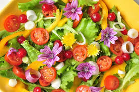 flowers fruit alkaline colorful salad with flowers fruit and vegetables stock